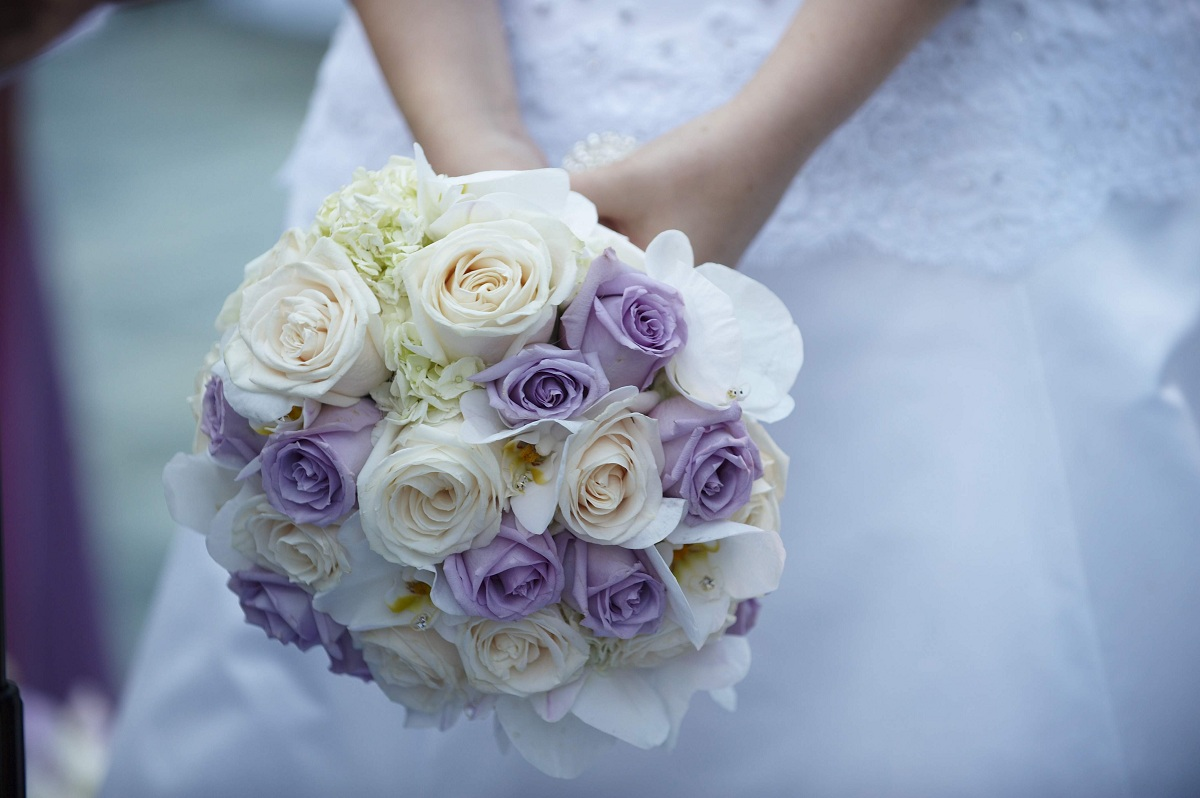 What Are The Purple Bouquets Of The Bride?